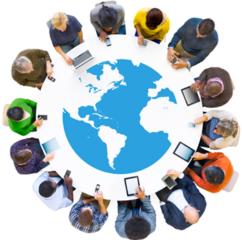 An overhead photograph of people sitting around a table with an image of the earth in the center.