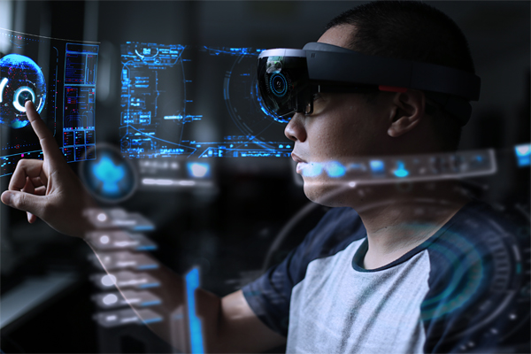 Young man using hololens to play in virtual reality