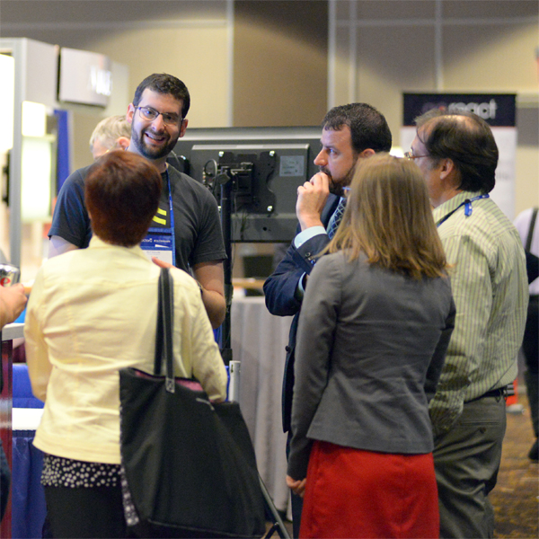 Sponsor Interacting with Conference Attendees