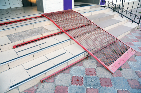 Example of Accessibility Bolt-On - Metal Ramp - Stone Building