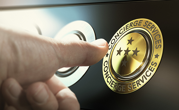 Man contacting concierge service by pushing a golden button. Composite image between a hand photography and a 3D background.