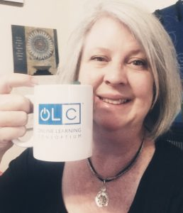 OLC Member Amy Pate holds up a coffee mug before an early morning session, submitted via Twitter @pate_al