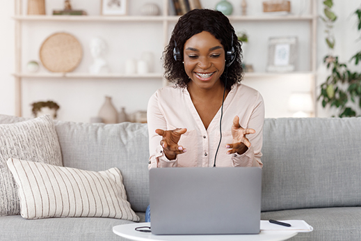 Woman sitting behind a computer screen