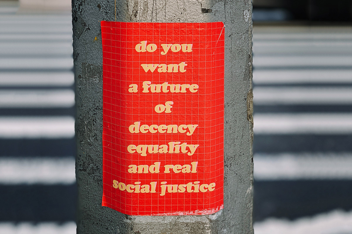 Sign on street pole that says do you want a future of decency equality and real social justice