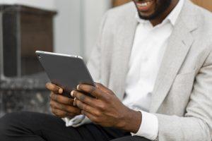 Black man looking at tablet