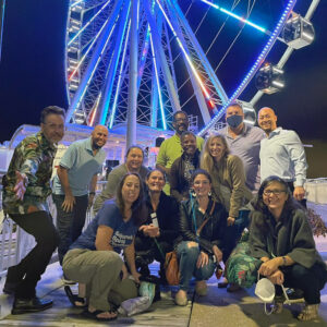 Group of OLC Accelerate attendees standing in front of Capital Wheel in National Harbor, Maryland