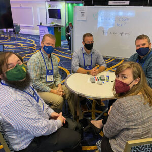 Group of OLC Accelerate 2021 Attendees working together in the Speed Networking Lounge