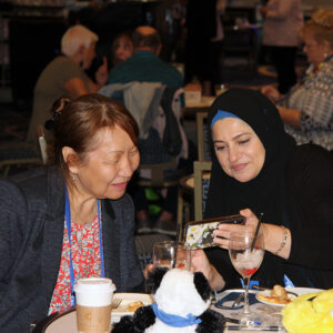 Photograph of OLC Accelerate attendee sharing something with another attendee