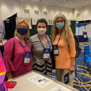 Group of OLC Accelerate 2021 Attendees in Exhibit Hall